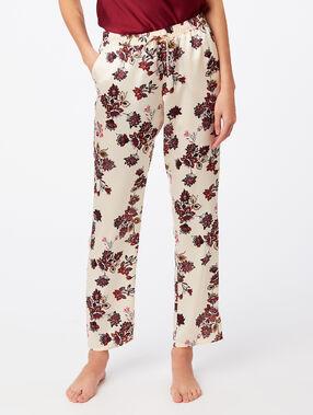 Широкие штаны с цветочным принтом экрю.