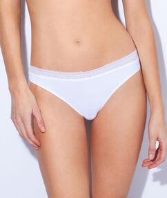 Трусики-танга из микроволокна и кружева белый.